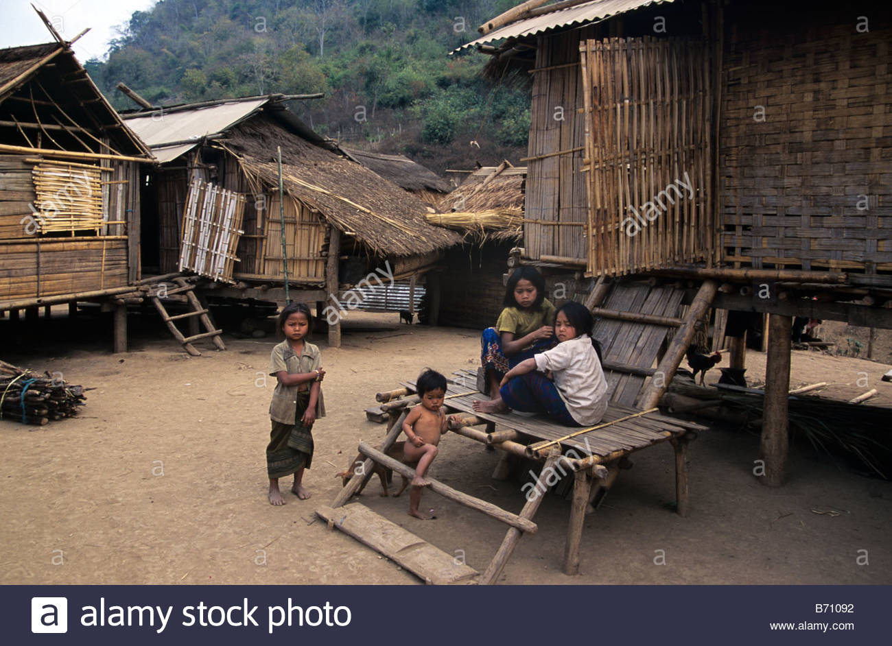 hmong-children-or-family-outside-their-traditional-bamboo-grass-houses-B71092.jpg