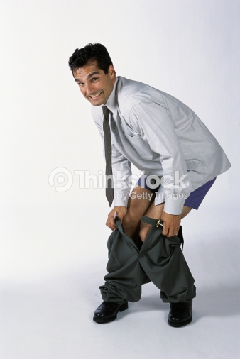 portrait-of-businessman-pulling-up-his-p
