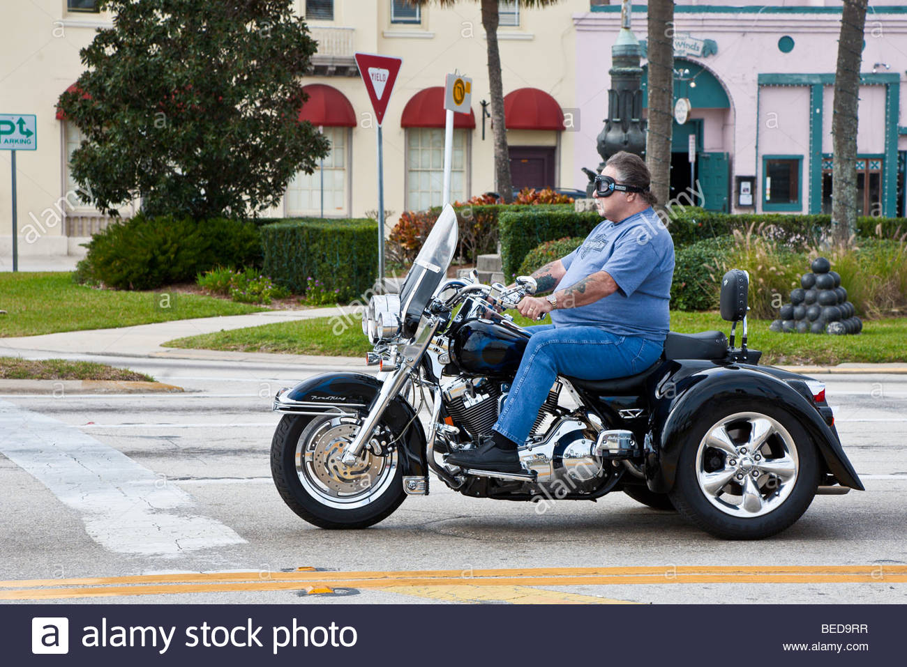 overweight-man-riding-three-wheeled-moto