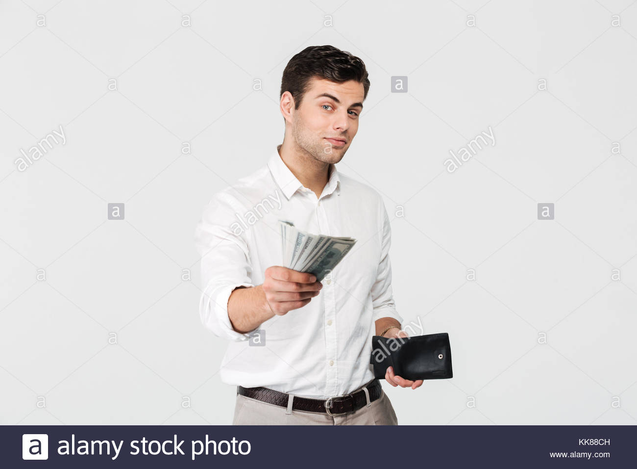 portrait-of-a-successful-smiling-man-holding-wallet-and-giving-money-KK88CH.jpg