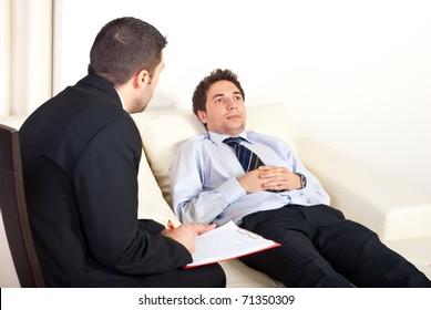 psychiatrist-man-talking-hypnotized-male