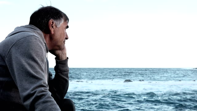 year-old-man-contemplating-the-sea-video