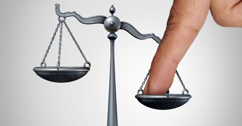 Finger-on-scales-of-justice-photo-780x40