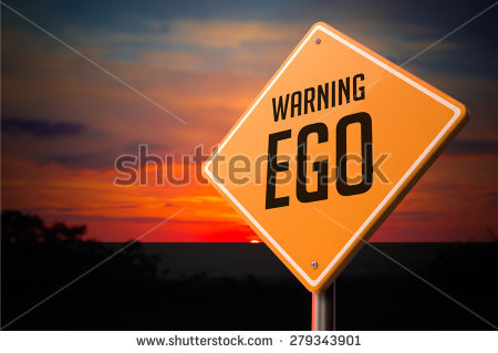 EGO on Warning Road Sign on Sunset Sky Background.