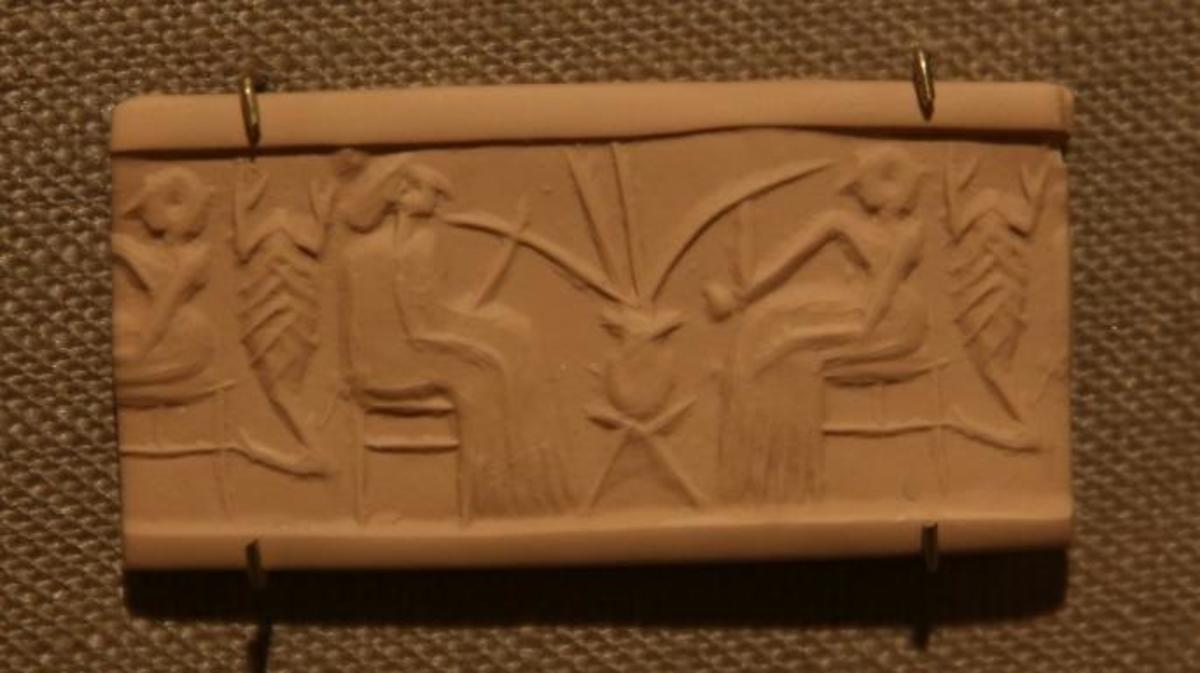 A clay seal depicting beer drinking in a banquet scene dating from 2600-2350 B.C. (Credit: E. Jason Wambsgans/Getty Images)